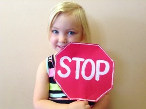 girl holding stop sign