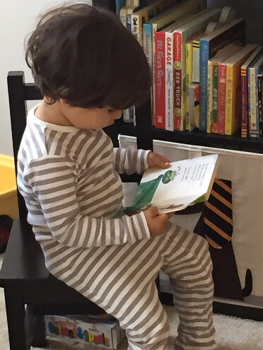 toddler reading a story book