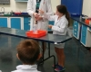 a girl assisting on a experiment