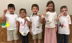 kids in white smiling