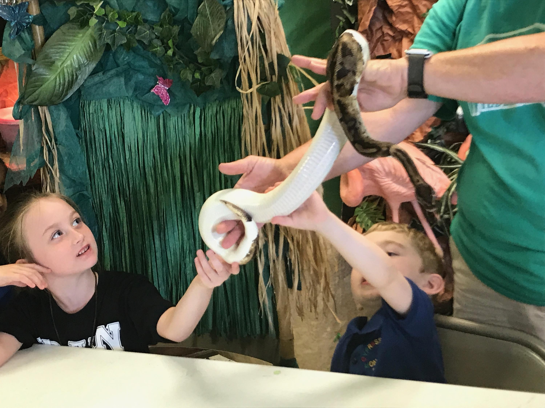 kids petting a snake